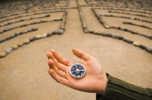 Woman Holding a Compass in a Labyrinth